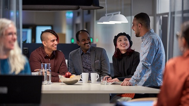 Four people talking and laughing 640x360