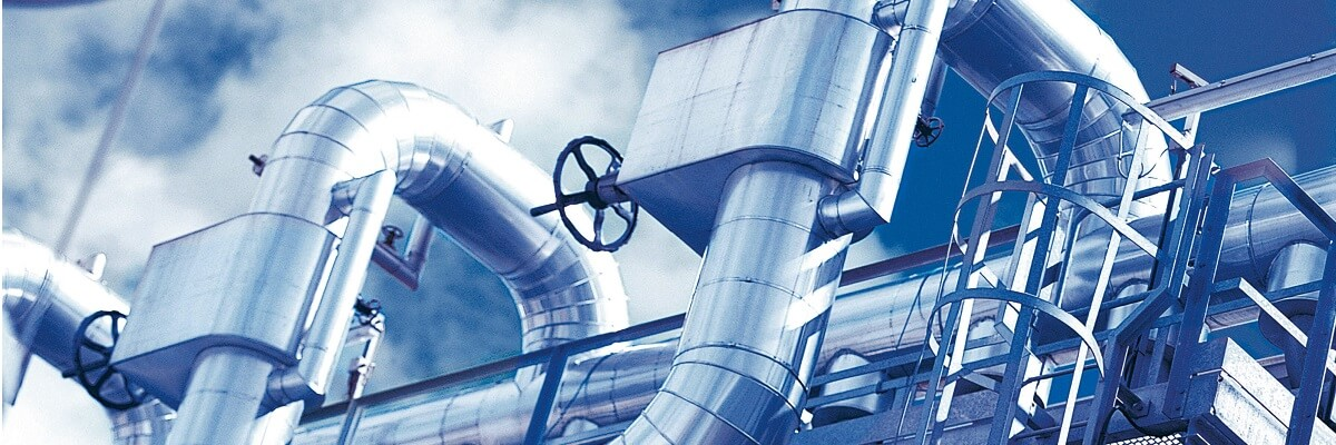 industry pipes in front of a blue sky