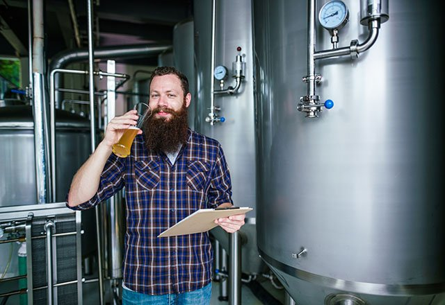 bearded man with a beer glass 640x360