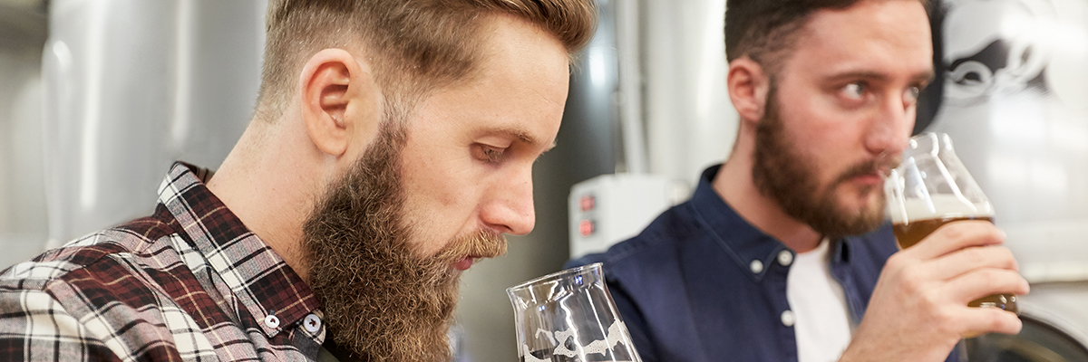 two men drinking beer tasting 1200 400 banner