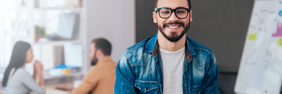 Smiling beardy guy in an office