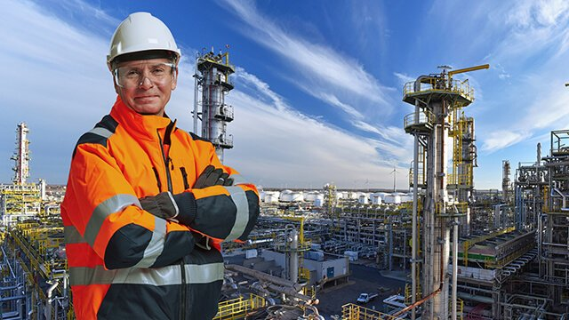 engineer-in-front-of-oil-refinery