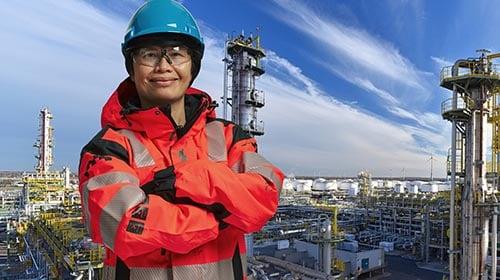 happy asian female oil worker