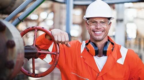 happy oil worker wearing orange
