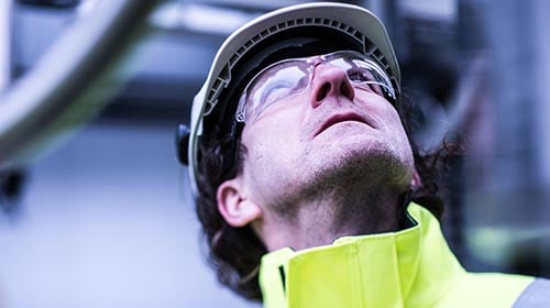 oil refinery worker outside looking up