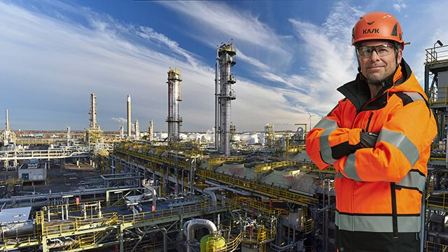 proud-engineer-in-front-of-oil-refinery-right