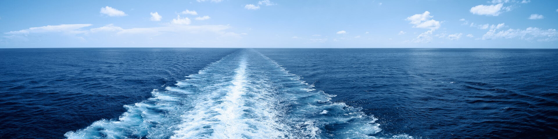 Sea with waves caused by a ship