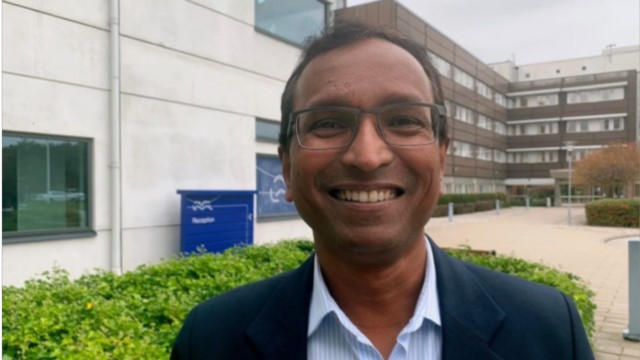 Amol outside the Alfa Laval office in Lund