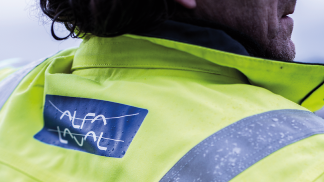 Man wearing a jacket with Alfa Laval logotype