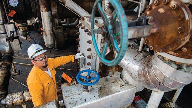 asian oil refinery worker