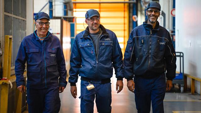 service-men-walking-in-workshop
