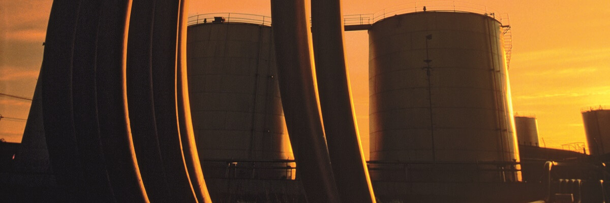 crude oil refinery tower at dawn