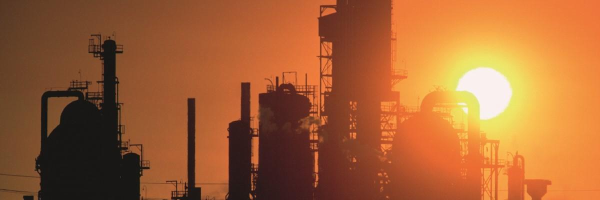 sunrise behind a petrochemical plant