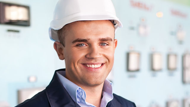 Man with hard hat smiling