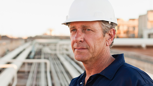 Man with hard hat staring into the distance