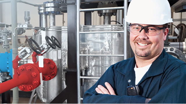 smiling engineer at printed circuit heat exchanger installation