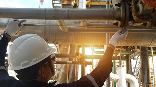 Engineer working on pipes at chemical plant