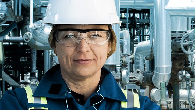 Female engineer wearing hard hat and safety glasses