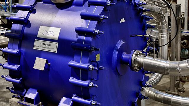 Closeup of a blue Alfa Laval welded spiral heat exchanger