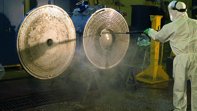 Man cleaning Alfa Laval welded spiral heat exchangers