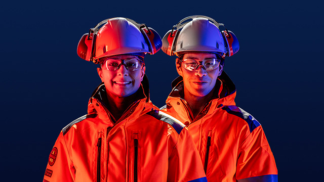 Male and femle engineers wearing hard hat and safety glasses