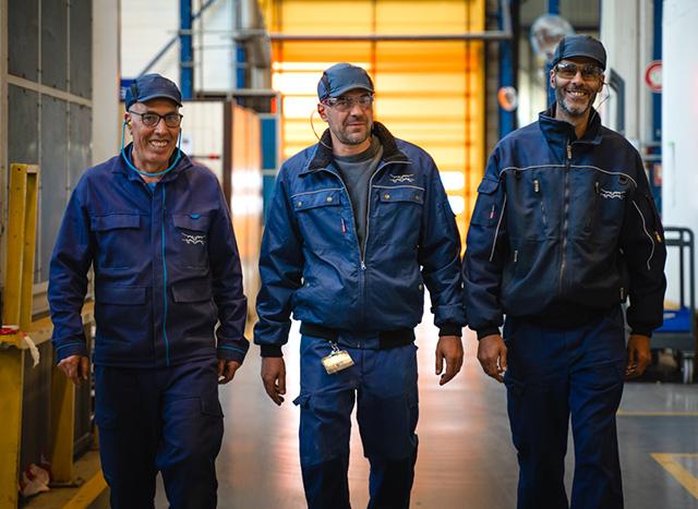 men walking in workshop